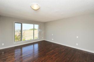 Photo 17: 315 Hawkdale Bay NW in Calgary: Hawkwood Detached for sale : MLS®# A1057091