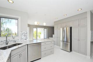 Photo 9: 315 Hawkdale Bay NW in Calgary: Hawkwood Detached for sale : MLS®# A1057091