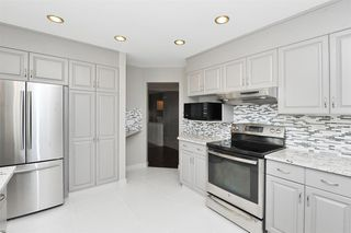 Photo 8: 315 Hawkdale Bay NW in Calgary: Hawkwood Detached for sale : MLS®# A1057091