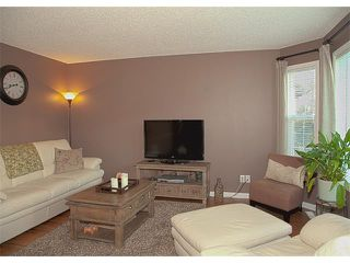 Photo 3: 17 CRYSTAL SHORES Heights: Okotoks House for sale : MLS®# C4017204