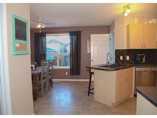 Photo 6: 17 CRYSTAL SHORES Heights: Okotoks House for sale : MLS®# C4017204