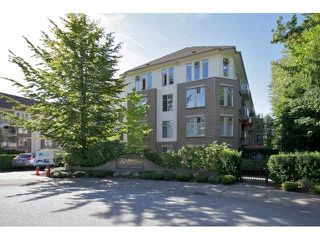 "Photo 1: 401 15340 19A Avenue in Surrey: King George Corridor Condo for sale in ""Stratford Gardens"" (South Surrey White Rock)  : MLS®# F1448318"