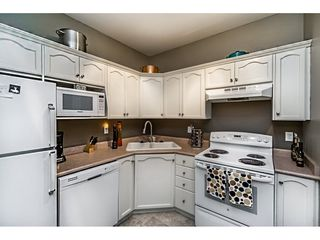 "Photo 5: 101A 301 MAUDE Road in Port Moody: North Shore Pt Moody Condo for sale in ""HERITAGE GRAND"" : MLS®# R2082721"