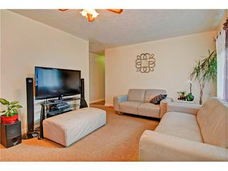 Photo 4: 4232 7 Avenue SW in Calgary: Rosscarrock House for sale : MLS®# C4078756
