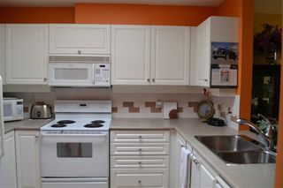 """Photo 7: 406 5650 OAK Street in Vancouver: Cambie Condo for sale in """"BLOOMFIELD GARDENS"""" (Vancouver West)  : MLS®# R2169257"""