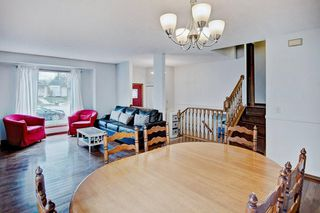 Photo 5: 959 MCKENZIE Drive SE in Calgary: McKenzie Lake House for sale : MLS®# C4183479