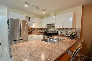 Photo 2: 110 12130 80 Avenue in Surrey: West Newton Condo for sale : MLS®# R2333682