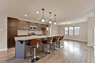 Photo 7: 3056 KESWICK Way in Edmonton: Zone 56 Attached Home for sale : MLS®# E4152118