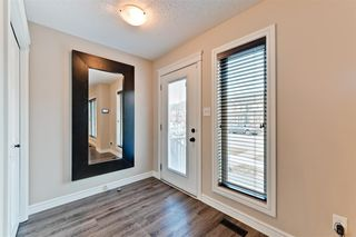 Photo 2: 3056 KESWICK Way in Edmonton: Zone 56 Attached Home for sale : MLS®# E4152118