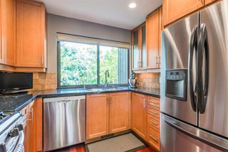 "Photo 11: 212 4001 MT SEYMOUR Parkway in North Vancouver: Dollarton Townhouse for sale in ""The Maples"" : MLS®# R2370933"