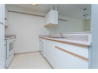 """Photo 4: 301 20881 56 Avenue in Langley: Langley City Condo for sale in """"ROBERT'S COURT"""" : MLS®# R2371965"""