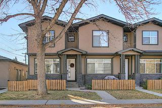 Photo 1: 1013 4 Street NE in Calgary: Renfrew Row/Townhouse for sale : MLS®# A1038777