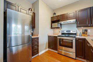 """Photo 6: 211 2109 ROWLAND Street in Port Coquitlam: Central Pt Coquitlam Condo for sale in """"PARK VIEW PLACE"""" : MLS®# R2511516"""