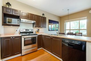 """Photo 4: 211 2109 ROWLAND Street in Port Coquitlam: Central Pt Coquitlam Condo for sale in """"PARK VIEW PLACE"""" : MLS®# R2511516"""