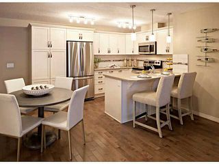 Photo 3: 105 102 CRANBERRY Park SE in Calgary: Cranston Condo for sale : MLS®# C3651019