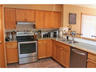 Photo 7: 2 CIMARRON MEADOWS Crescent: Okotoks House for sale : MLS®# C3654691