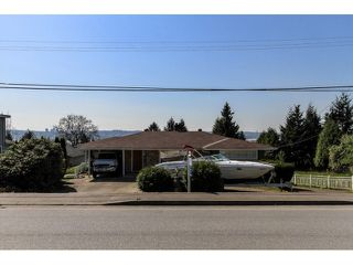 Main Photo: 828 EDGAR Avenue in Coquitlam: Coquitlam West House for sale : MLS®# V1112251