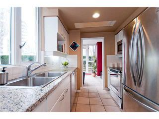 Photo 4: 302 1201 MARINASIDE CR in PENINSULA: Home for sale : MLS®# V875824