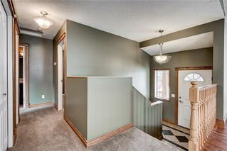 Photo 2: 306 Robert Street SW: Turner Valley House for sale : MLS®# C4132445