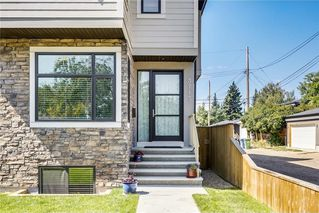Photo 2: 3713 43 Street SW in Calgary: Glenbrook House for sale : MLS®# C4134793