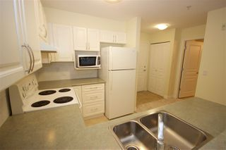 """Photo 4: 208 960 LYNN VALLEY Road in North Vancouver: Lynn Valley Condo for sale in """"Balmoral House"""" : MLS®# R2384917"""