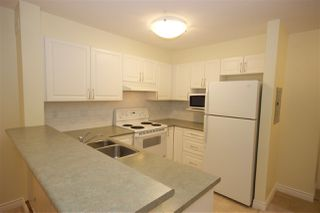"""Photo 3: 208 960 LYNN VALLEY Road in North Vancouver: Lynn Valley Condo for sale in """"Balmoral House"""" : MLS®# R2384917"""