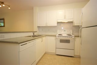 """Photo 2: 208 960 LYNN VALLEY Road in North Vancouver: Lynn Valley Condo for sale in """"Balmoral House"""" : MLS®# R2384917"""