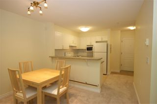 """Photo 5: 208 960 LYNN VALLEY Road in North Vancouver: Lynn Valley Condo for sale in """"Balmoral House"""" : MLS®# R2384917"""