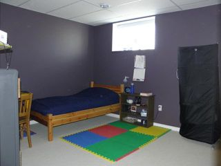 Photo 14: 56 Robidoux Road in CARTIERRM: Elie / Springstein / St. Eustache Residential for sale (Winnipeg area)  : MLS®# 1122423