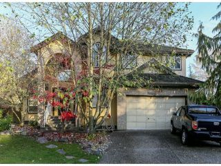 "Photo 1: 7926 REDTAIL Place in Surrey: Bear Creek Green Timbers House for sale in ""Hawkstream"" : MLS®# F1405519"