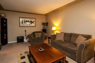 """Photo 4: 107 19908 56 Avenue in Langley: Langley City Townhouse for sale in """"Chenier Place"""" : MLS®# R2078671"""