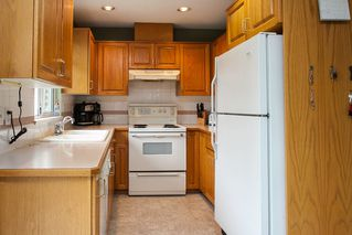 """Photo 7: 107 19908 56 Avenue in Langley: Langley City Townhouse for sale in """"Chenier Place"""" : MLS®# R2078671"""