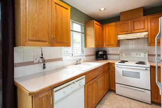 """Photo 6: 107 19908 56 Avenue in Langley: Langley City Townhouse for sale in """"Chenier Place"""" : MLS®# R2078671"""