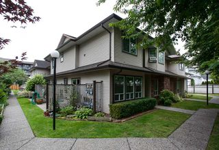 """Photo 1: 107 19908 56 Avenue in Langley: Langley City Townhouse for sale in """"Chenier Place"""" : MLS®# R2078671"""