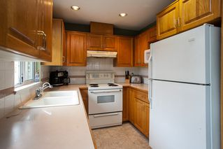 """Photo 5: 107 19908 56 Avenue in Langley: Langley City Townhouse for sale in """"Chenier Place"""" : MLS®# R2078671"""
