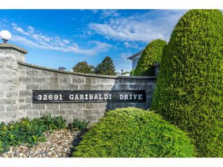 "Photo 1: 48 32691 GARIBALDI Drive in Abbotsford: Abbotsford West Townhouse for sale in ""Carriage Lane"" : MLS®# R2096442"