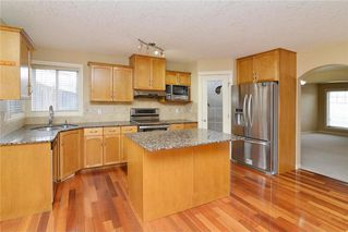 Photo 5: 220 COVEMEADOW Court NE in Calgary: Coventry Hills House for sale : MLS®# C4160697
