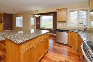 Photo 8: 220 COVEMEADOW Court NE in Calgary: Coventry Hills House for sale : MLS®# C4160697