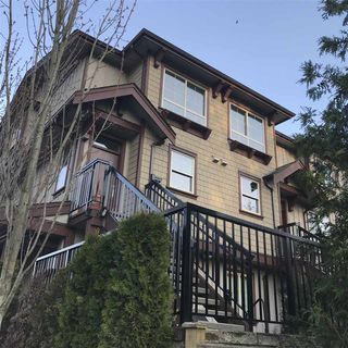 "Photo 1: 17 433 SEYMOUR RIVER Place in North Vancouver: Seymour NV Townhouse for sale in ""Maplewood Place"" : MLS®# R2252080"