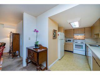 "Photo 8: 105 7144 133B Street in Surrey: West Newton Townhouse for sale in ""Suncreek Estates"" : MLS®# R2311916"