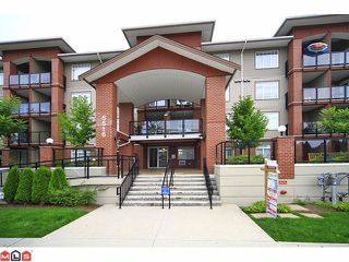 "Photo 1: 301 5516 198 Street in Langley: Langley City Condo for sale in ""Madison Villa"" : MLS®# R2440816"