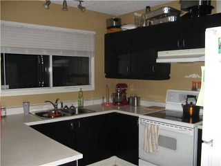 Photo 5: 100 GLENHILL Drive in : Cochrane Residential Detached Single Family for sale : MLS®# C3592319