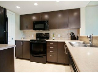 """Photo 2: 206 295 GUILDFORD Way in Port Moody: North Shore Pt Moody Condo for sale in """"THE BENTLEY"""" : MLS®# V1084423"""