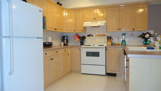 "Photo 3: 12 39754 GOVERNMENT Road in Squamish: Northyards Townhouse for sale in ""Mapletree Court"" : MLS®# R2013701"