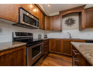 """Photo 6: 212 2627 SHAUGHNESSY Street in Port Coquitlam: Central Pt Coquitlam Condo for sale in """"VILLAGIO"""" : MLS®# R2120924"""