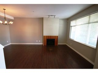 """Photo 2: 104 6878 SOUTHPOINT Drive in Burnaby: South Slope Townhouse for sale in """"CORTINA"""" (Burnaby South)  : MLS®# V878295"""