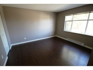 """Photo 5: 104 6878 SOUTHPOINT Drive in Burnaby: South Slope Townhouse for sale in """"CORTINA"""" (Burnaby South)  : MLS®# V878295"""