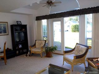Photo 2: 106 264 McVickers St in PARKSVILLE: PQ Parksville Row/Townhouse for sale (Parksville/Qualicum)  : MLS®# 685945