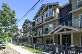 "Photo 1: 103 3382 VIEWMOUNT Drive in Port Moody: Port Moody Centre Townhouse for sale in ""Lillium Villas"" : MLS®# R2187469"
