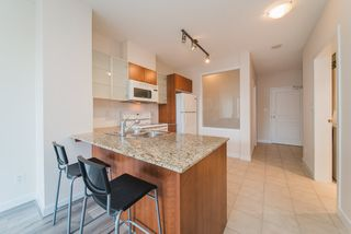 "Photo 1: 408 4078 KNIGHT Street in Vancouver: Knight Condo for sale in ""KING EDWARD VILLAGE"" (Vancouver East)  : MLS®# R2367118"